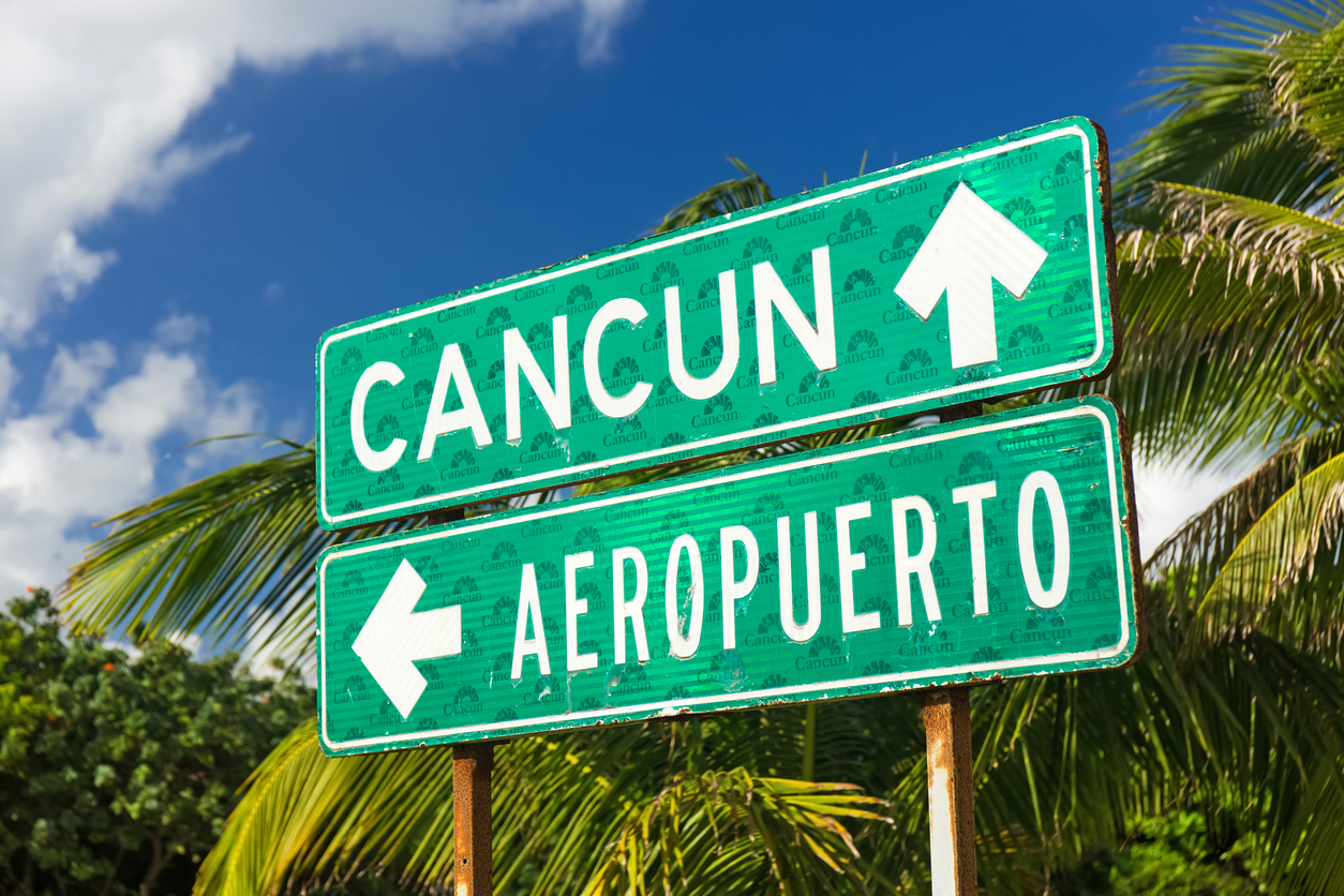 Cancun, Mexico - December 12, 2015: Traffic Sign Airport or Cancun with arrows on the street at Hotel Zone